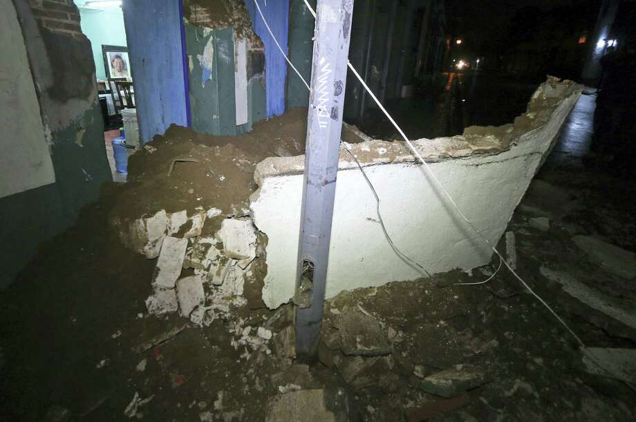 Debris from a collapsed wall sits in Oaxaca, Mexico, after an earthquake early Friday, Sept. 8, 2017. A massive 8-magnitude earthquake hit off the coast of southern Mexico late Thursday night, causing buildings to sway violently and people to flee into the street in panic as far away as the capital city. Photo: AP Photo/Luis Alberto Cruz   / Copyright 2017 The Associated Press. All rights reserved.
