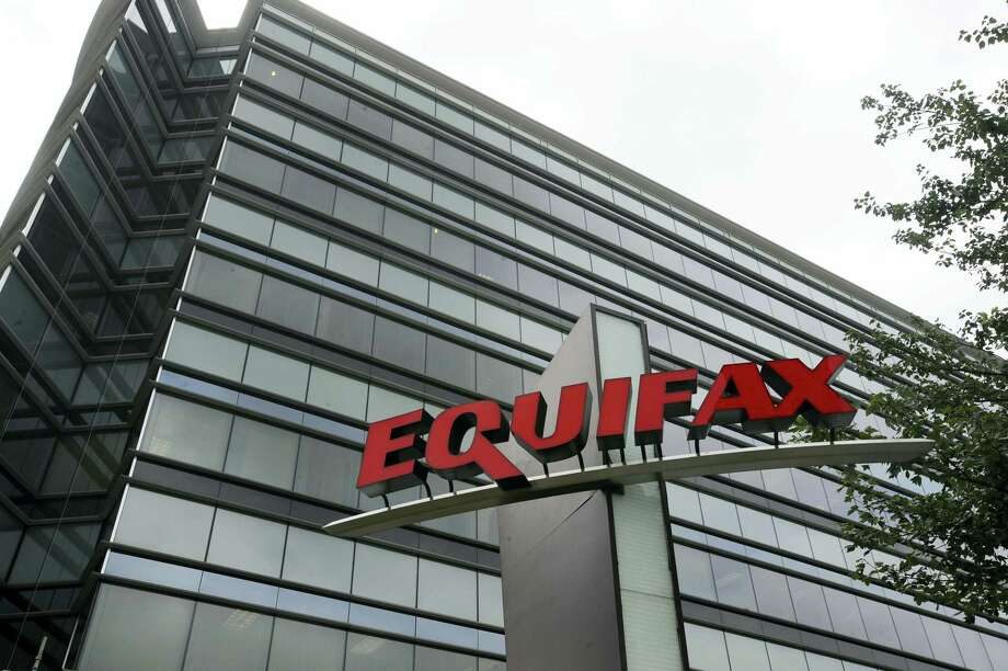 """This July 21, 2012, photo shows Equifax Inc., offices in Atlanta. Credit monitoring company Equifax says a breach exposed social security numbers and other data from about 143 million Americans. The Atlanta-based company said Thursday, Sept. 7, 2017, that """"criminals"""" exploited a U.S. website application to access files between mid-May and July of this year. Photo: Mike Stewart / AP Photo  / Copyright 2017 The Associated Press. All rights reserved."""