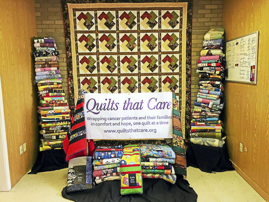 Quilts that Care members are selling tickets for their annual fundraiser in October. Photo: Contributed Photo
