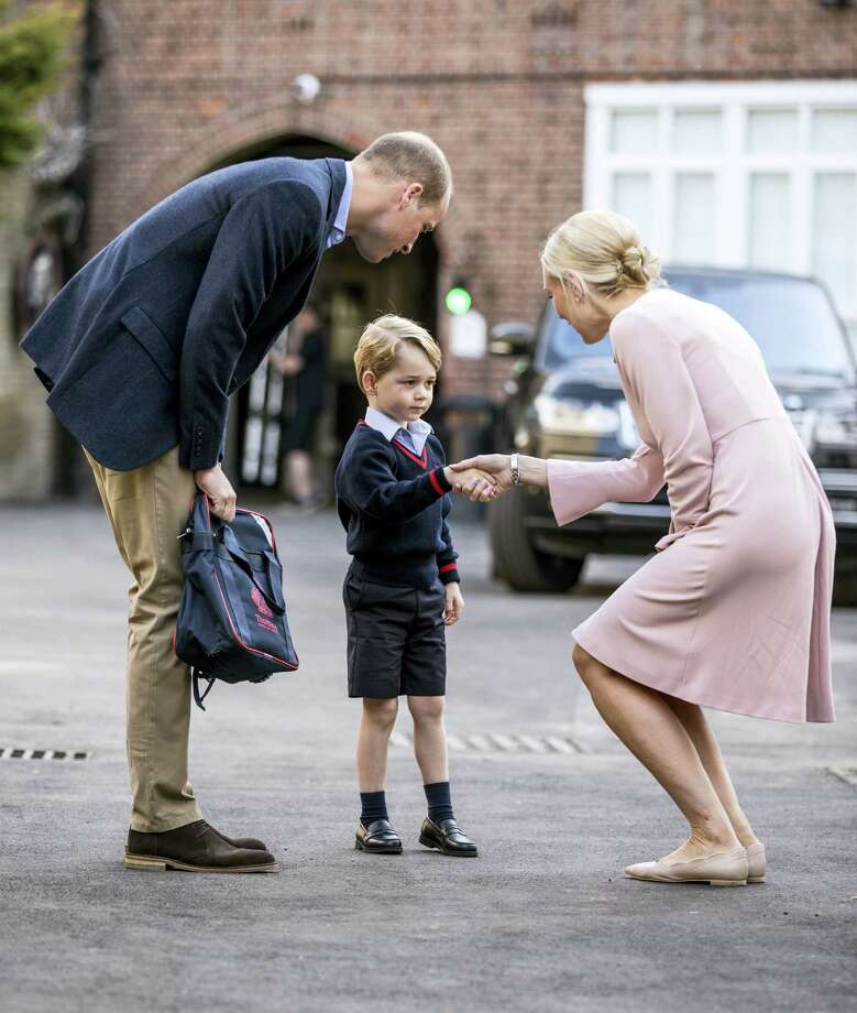 Britain's Prince William accompanies Prince George as he is greeted by Helen Haslem - the head of the lower school as he arrives for his first day of school at Thomas's school in Battersea, London, Thursday, Sept. 7, 2017.  Prince William's pregnant wife Kate was too ill with morning sickness Thursday to take young Prince George to his first day of school. Photo: Richard Pohle/Pool Photo Via AP   / Times Newspapers Ltd