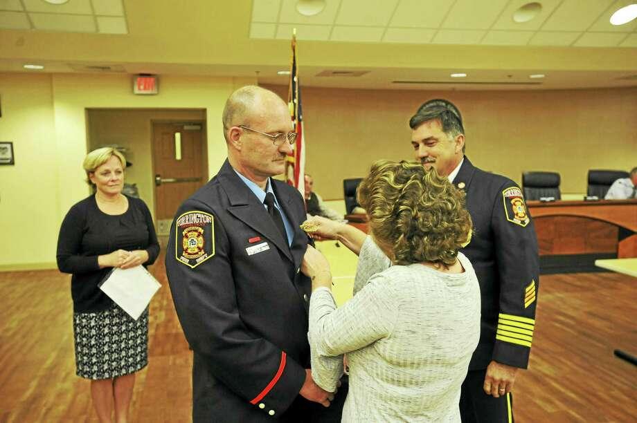 Longtime Torrington firefighter Phil Hearn was promoted to deputy fire marshal Wednesday evening. Photo: Ben Lambert / Hearst Connecticut Media
