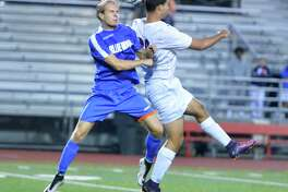 Darien's #9 Max Marcin gets to the ball behind Brien McMahon's #26 Elias Pardo during Boys soccer action at Brien McMahon High School on Tuesday September 19, 2017 in Norwalk Conn.