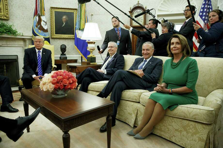 President Donald Trump meets with, from left, Senate Majority Leader Mitch McConnell, R-Ky., Senate Minority Leader Chuck Schumer, D-N.Y., and House Minority Leader Nancy Pelosi, D-Calif., and other Congressional leaders in the Oval Office of the White House, Wednesday, Sept. 6, 2017, in Washington. Photo: Evan Vucci / AP Photo  / Copyright 2017 The Associated Press. All rights reserved.