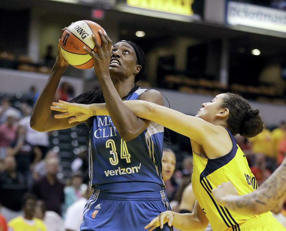 Minnesota Lynx's Sylvia Fowles is fouled by Indiana Fever's Natalie Achonwa as she goes up for a shot during the first half of a WNBA basketball game on Aug. 30, 2017 in Indianapolis. Photo: AP Photo — Darron Cummings  / Copyright 2017 The Associated Press. All rights reserved.