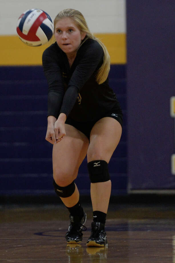 Midland High's Reagan Squire (3) takes a serve from Odessa on Sept. 19, 2017 at MHS. James Durbin/Reporter-Telegram Photo: James Durbin
