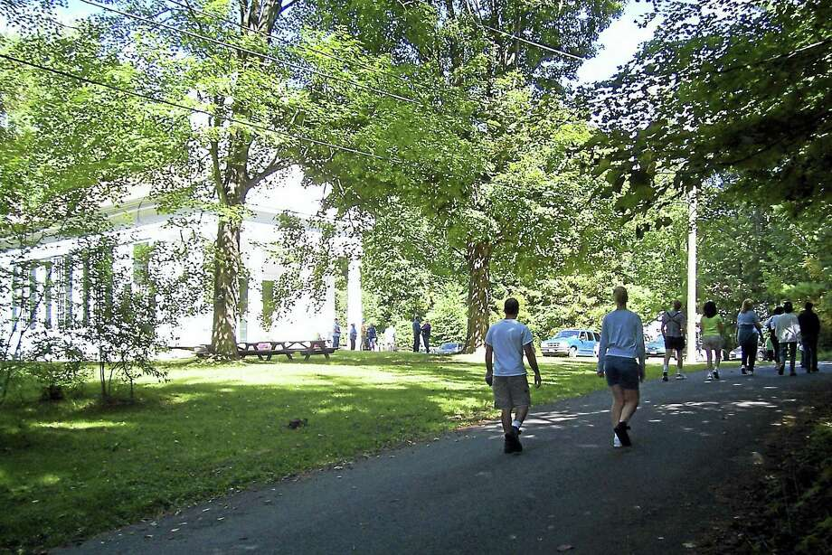 Guests from last year's Old Home Day walk past the church in Barkhamsted. Photo: Contributed Photo