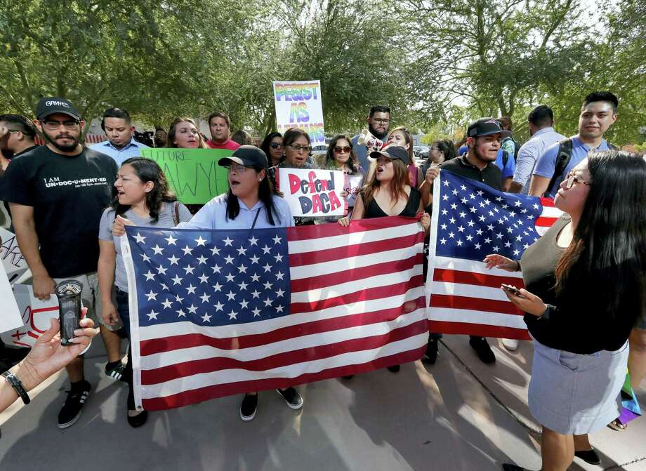 DACA supporters march to the Immigration and Customs Enforcement office to protest shortly after U.S. Attorney General Jeff Sessions' announcement that the Deferred Action for Childhood Arrivals (DACA), will be suspended with a six-month delay, Tuesday, Sept. 5, 2017, in Phoenix. President Donald Trump on Tuesday began dismantling the Deferred Action for Childhood Arrivals, or DACA, program, the government program protecting hundreds of thousands of young immigrants who were brought into the country illegally as children. Photo: Matt York / AP Photo  / Copyright 2017 The Associated Press. All rights reserved.