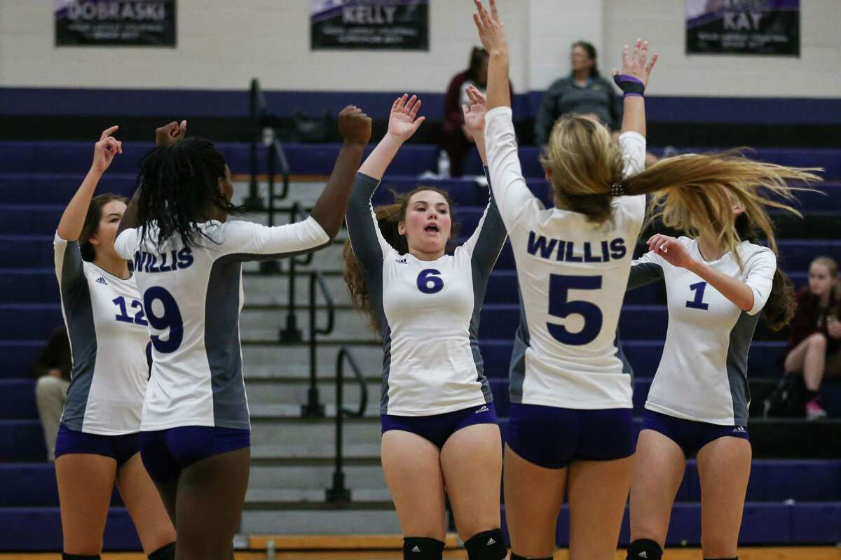 Willis teammates celebrate during the varsity volleyball game against Magnolia West on Tuesday, Sept. 19, 2017, at Willis High School. (Michael Minasi / Chronicle)