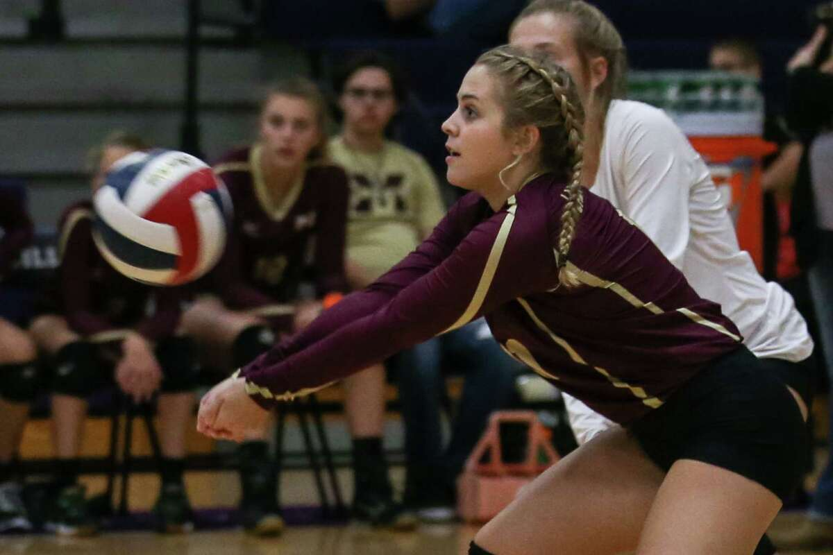 Magnolia West's Kylie Kirtley (11) digs the ball during the varsity volleyball game against Willis on Tuesday at Willis High School.