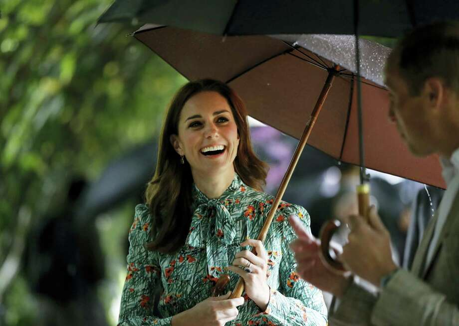 Britain's Prince William and his wife, Kate, Duchess of Cambridge, smile as they walk through the memorial garden at Kensington Palace, London, Wednesday, Aug. 30, 2017, honoring the late Princess Diana. Buckingham Palace has announced that the duchess is expecting the couple's third child and that she is again suffering from severe morning sickness. Photo: AP Photo/Kirsty Wigglesworth   / Copyright 2017 The Associated Press. All rights reserved.