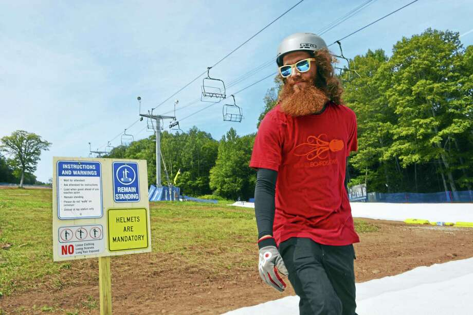 With the mercury at 70 degrees Saturday in Middlefield, skiers were hitting the slopes a full three weeks before the start of autumn at Powder Ridge Park. Photo: Cassandra Day — Hearst Connecticut Media