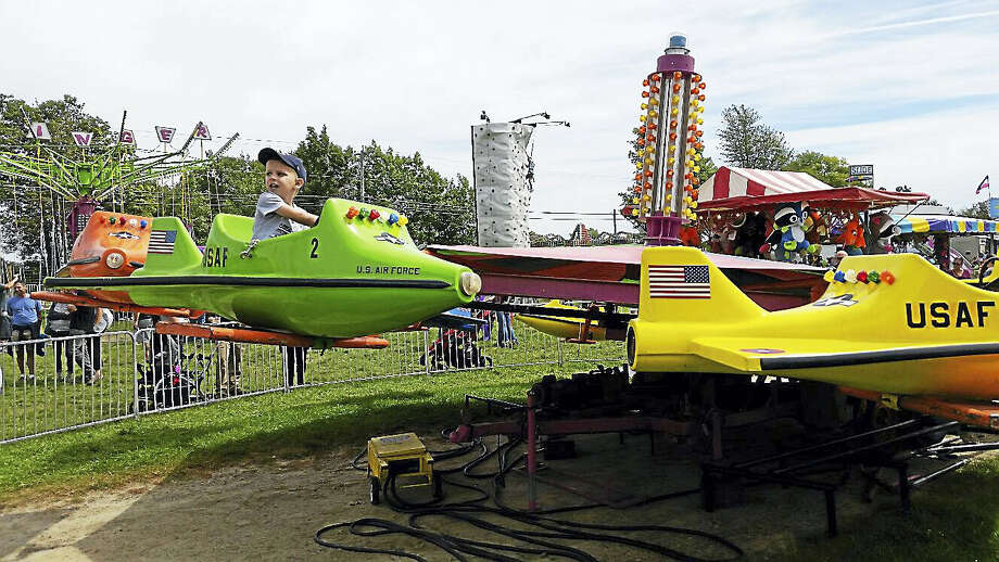 A child rode on an amusement park ride during the 105th year of the Goshen Fair at the Goshen Fair Grounds at 116 Old Middle Street in Goshen. The Fair will continue today, 8 a.m. to 9 p.m., and Monday, 8 a.m. to 6 p.m. Photo: Nf Ambery