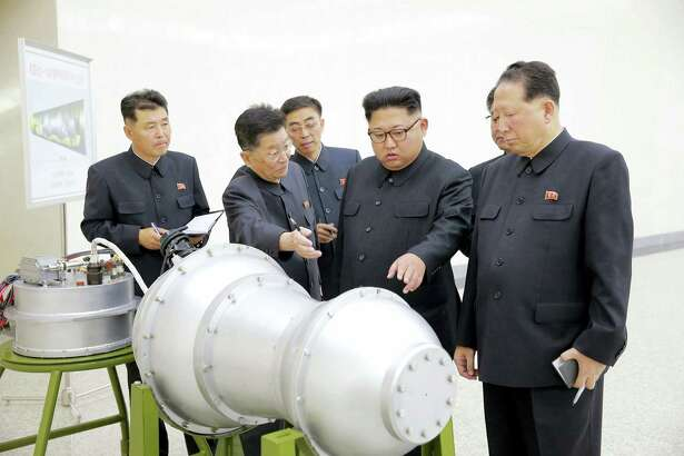 In this undated image distributed on Sunday, Sept. 3, 2017, by the North Korean government, shows North Korean leader Kim Jong Un at an undisclosed location. North Korea's state media on Sunday, Sept 3, 2017, said leader Kim Jong Un inspected the loading of a hydrogen bomb into a new intercontinental ballistic missile, a claim to technological mastery that some outside experts will doubt but that will raise already high worries on the Korean Peninsula. Independent journalists were not given access to cover the event depicted in this image distributed by the North Korean government. The content of this image is as provided and cannot be independently verified.
