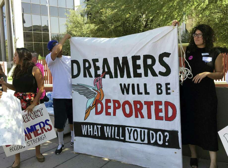 Immigrant rights groups, advocating for DACA, the program that allows youths who were brought to the country illegally as children to legally work and be shielded from deportation, rally in Phoenix, Ariz., Monday, Aug. 28, 2017. President Donald Trump is deciding whether to keep the program as Republican officials from 10 states have threatened to sue to stop the program, giving Trump a Sept. 5 deadline to act. Photo: AP Photo/Astrid Galvan   / Copyright 2017 The Associated Press. All rights reserved.