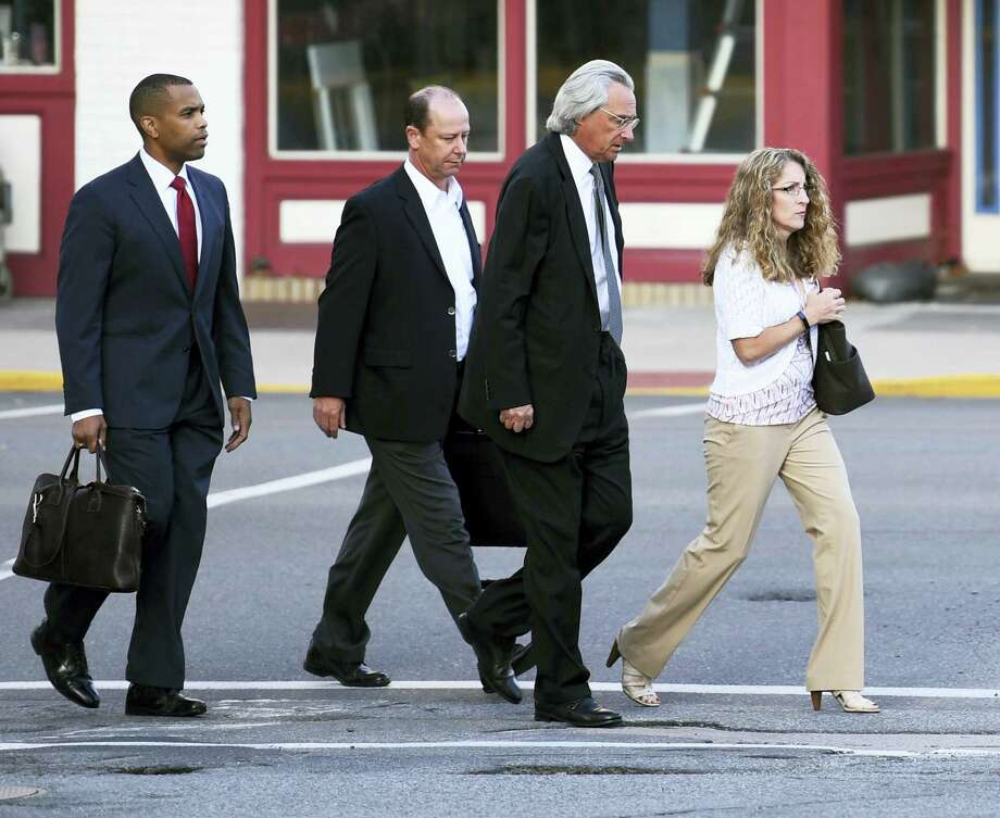 From right, Evelyn Piazza, attorney Tom Kline and  Jim Piazza and walk toward the courthouse before a preliminary hearing resumes for members of a fraternity facing criminal charges over the death of Timothy Piazza, at the Centre County Courthouse in Bellefonte, Pa.  Piazza, a 19-year-old sophomore, suffered severe head and abdominal injuries last February, after consuming a dangerous amount of alcohol and fell repeatedly.  Help wasn't summoned until the next morning, and he later died at a hospital. Photo: Phoebe Sheehan/Centre Daily Times Via AP   / Centre Daily Times