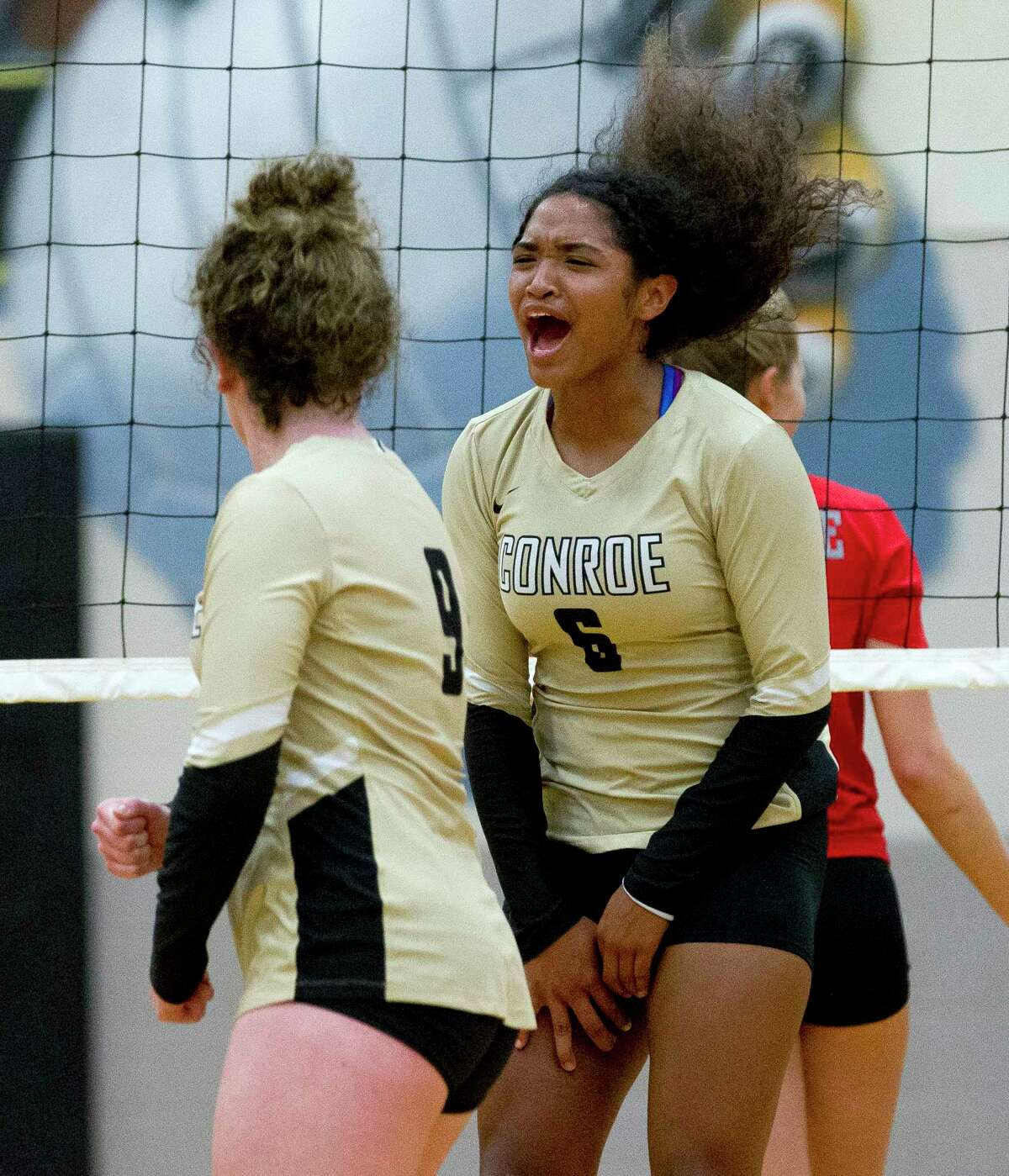 Conroe's Jznae Kim (6) celebrates a point during the first set of a District 12-6A volleyball match at Conroe High School, Tuesday, Sept. 19, 2017, in Conroe.