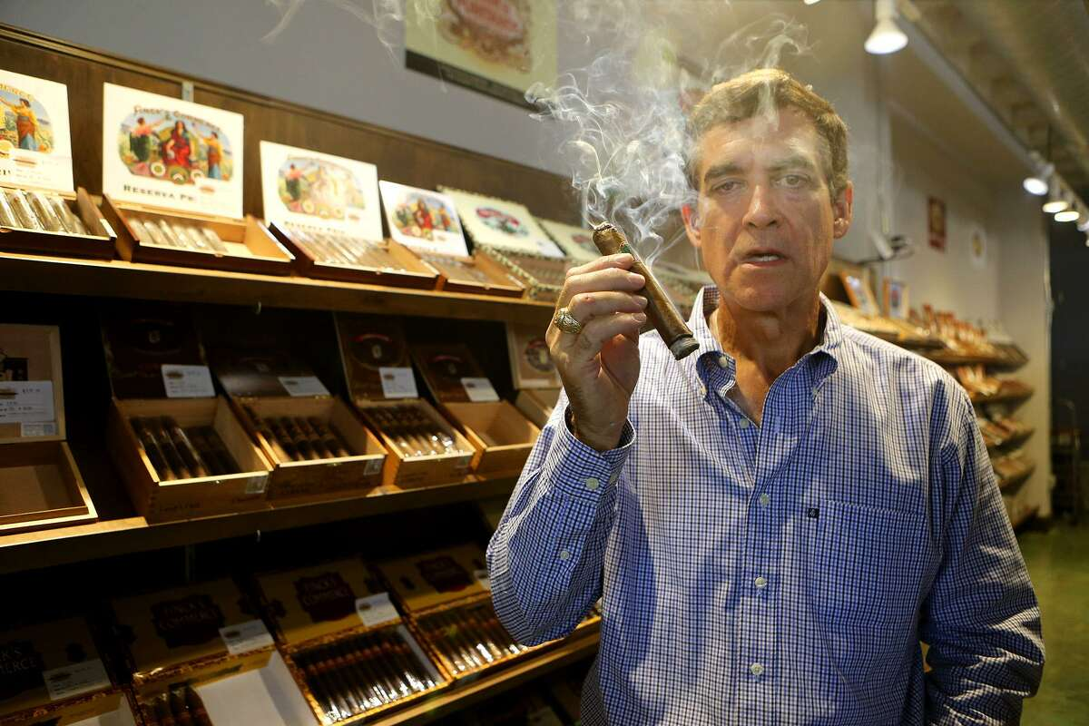 Bill Finck, Jr. enjoys a cigar Sept. 8 at his Finck Cigars store at 3111 Broadway in San Antonio. His great-grandfather started the Finck Cigar Co. in 1893 and it produced cigars for 121 years until 2014. Its cigars are now made elsewhere, including in the Dominican Republic, Honduras and Nicaragua.