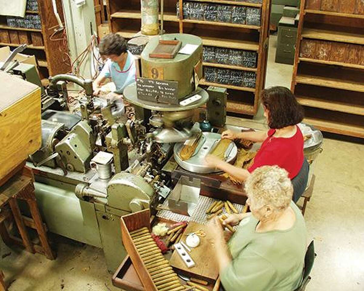 This undated photo taken around 2000 shows one of the machines that Finck Cigar Co. used to produce stogies at its San Antonio factory. Production ended at the factory in 2014.