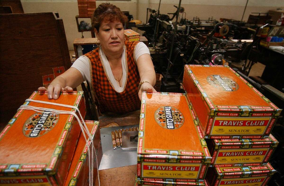 Antonia Soto boxes up cigars at the Finck Cigar Co. in San Antonio in 2004. The company stopped production at its San Antonio factory in 2014.