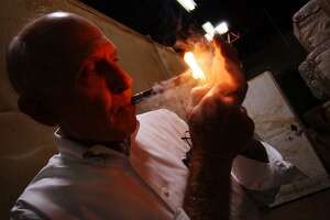 Bill Finck of the Finck Cigar Co. is seen in August 2004. Finck served in the Texas House of Representatives and was the Bexar County Treasurer. He died July 10, 2018 at the age of 87.