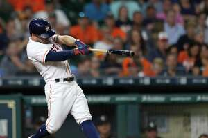 Houston Astros Jose Altuve (27) hits a home run during the fourth inning of an MLB baseball game at Minute Maid Park, Tuesday, Sept. 19, 2017, in Houston.