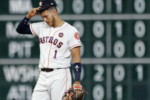 Houston Astros shortstop Carlos Correa (1) wears cleats with a Puerto Rican flag on them during the fourth inning of an MLB baseball game at Minute Maid Park, Tuesday, Sept. 19, 2017, in Houston.