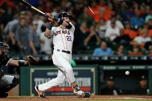 Houston Astros Josh Reddick (22) breaks his bat during the first inning of an MLB baseball game at Minute Maid Park, Tuesday, Sept. 19, 2017, in Houston.
