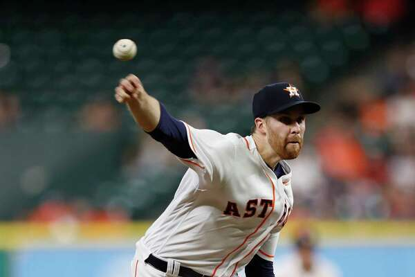 Houston Astros starting pitcher Collin McHugh (31) pitches during the first inning of an MLB baseball game at Minute Maid Park, Tuesday, Sept. 19, 2017, in Houston.