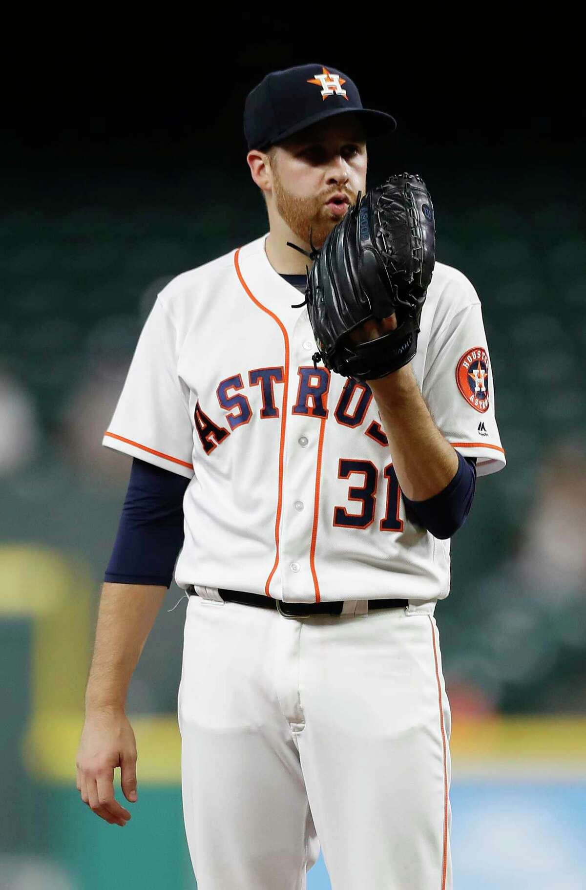 Houston Astros starting pitcher Collin McHugh (31) between pitches during the first inning of an MLB baseball game at Minute Maid Park, Tuesday, Sept. 19, 2017, in Houston.