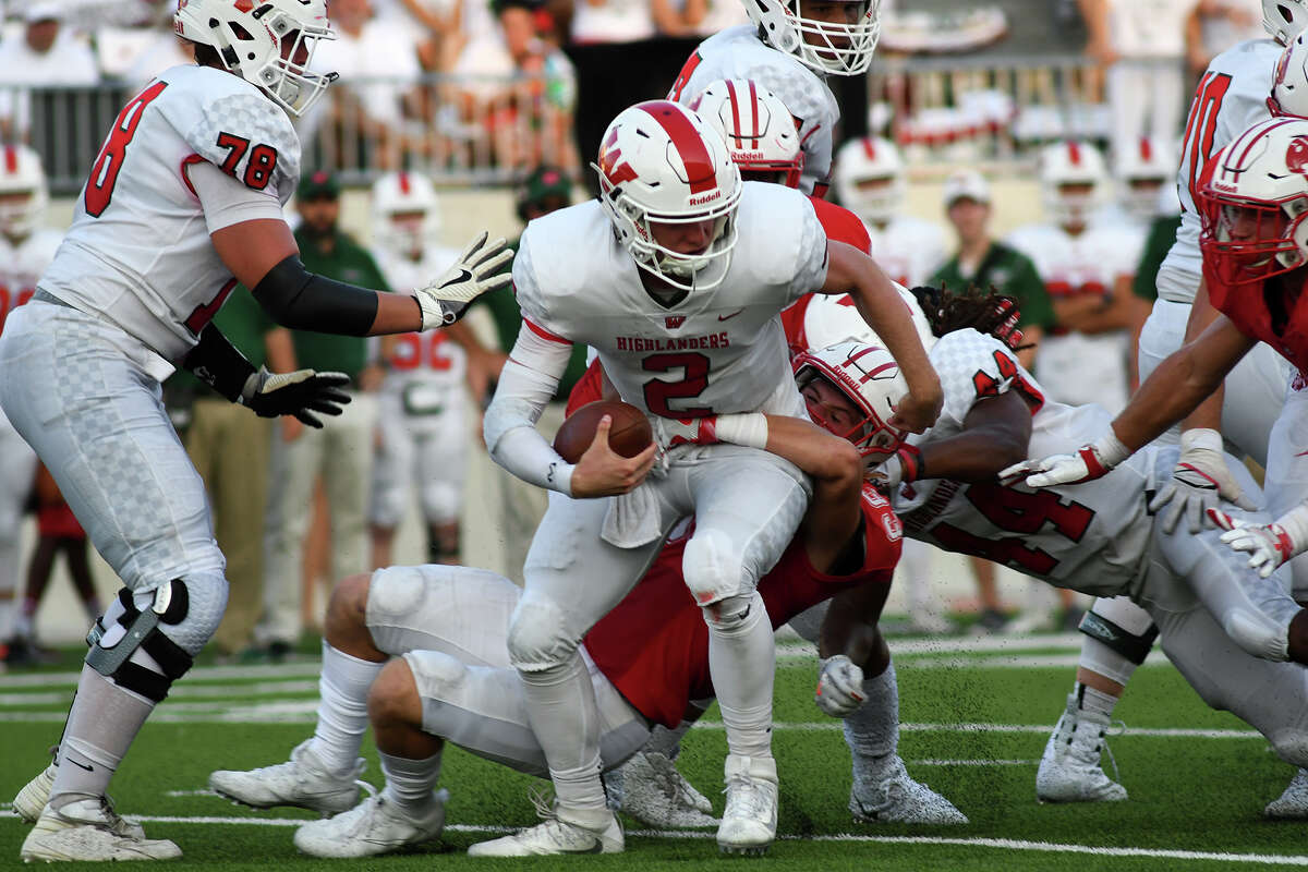The Woodlands senior quarterback Quinn Binney (2) gets sacked by Katy senior linebacker Neil Solis, center, last Saturday. in the 2nd quarter of their season opening matchup at Legacy Stadium in Katy on Saturday, Sept. 16, 2017. (Photo by Jerry Baker/Freelance)