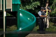 Law enforcement officers place crime scene tape near a playground after a shooting during a practice of the Republican congressional baseball at Eugene Simpson Statium Park June 14, 2017 in Alexandria, Virginia. At least five people people including a top Republican congressman were wounded in a Washington suburb early Wednesday morning when a shooting erupted as they practiced for an annual baseball game between lawmakers. Senior congressman Steve Scalise was shot in the hip, according to fellow Republican lawmaker Mo Brooks who told CNN at least two law enforcement officers and one congressional staffer were also shot in the incident in Alexandria, Virginia.  / AFP PHOTO / Brendan Smialowski        (Photo credit should read BRENDAN SMIALOWSKI/AFP/Getty Images)