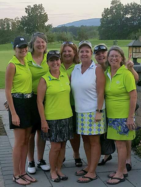 Members of the Shaker Ridge interclub finals championship team wore blue ribbons in honor of teammate  Jana Behe-Kinneston, who died unexpectedly. Team members are, from left, Katie Nelson, Kate Wasson, Susan Wronowski, Kim Scheuer, Dee Cocca, Sue Delanoy and Kathy McLaughlin. Jean Goldsmith, not pictured, also was on the winning team.