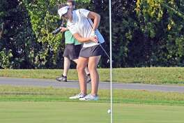 Edwardsville sophomore Jessica Benson watches her putt roll towards the hole during Tuesday's Southwestern Conference match at Granite City.
