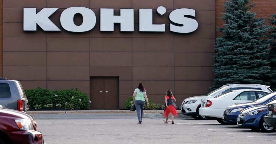 In this Tuesday, Aug. 22, 2017, photo, shoppers walk to a Kohl's retail store in Salem, N.H. Kohl's, which is opening some in-store Amazon shops, will start accepting returns for the online retailer at some of its stores in Los Angeles and Chicago starting in October 2017. (AP Photo/Charles Krupa) Photo: Charles Krupa, STF / Copyright 2017 The Associated Press. All rights reserved.