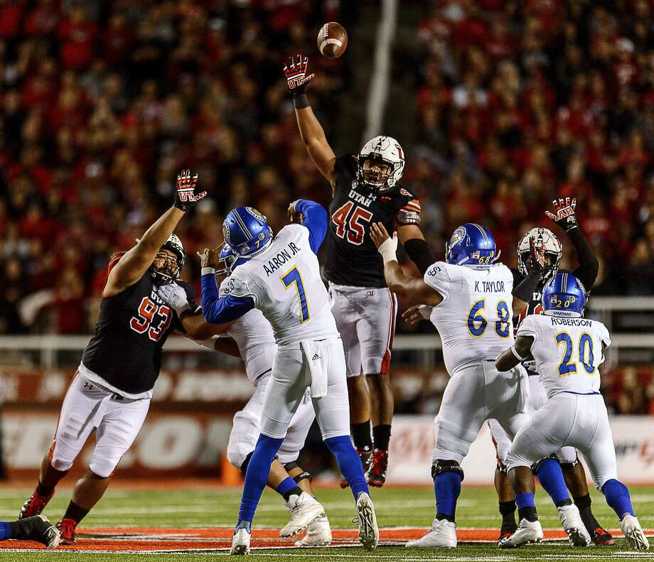 Utah defensive tackle Lowell Lotulelei (93) and defensive tackle Filipo Mokofisi (45) leap up after a pass by San Jose State quarterback Montel Aaron (7) during an NCAA college football game Saturday, Sept. 16, 2017, in Salt Lake City. (Trent Nelson/The Salt Lake Tribune via AP) Photo: Trent Nelson, Associated Press