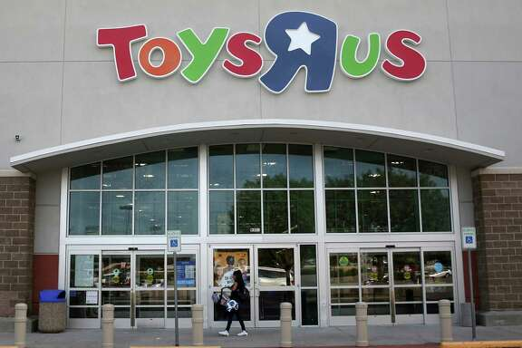 A customer walks into a Toys R Us store in Dallas, Tuesday, Sept. 19, 2017. Toys R Us has filed for Chapter 11 bankruptcy protection while continuing with normal business operations. (AP Photo/LM Otero)