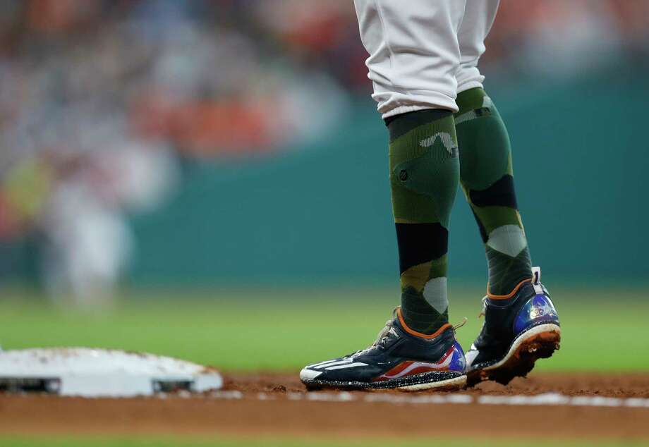 Houston Astros shortstop Carlos Correa (1) stands on first base with his Puerto Rico flag shoes during the second inning of an MLB baseball game at Minute Maid Park, Sunday, May 28, 2017.   ( Karen Warren / Houston Chronicle ) Photo: Karen Warren, Staff Photographer / 2017 Houston Chronicle
