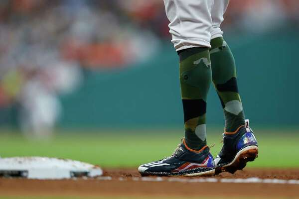 Houston Astros shortstop Carlos Correa (1) stands on first base with his Puerto Rico flag shoes during the second inning of an MLB baseball game at Minute Maid Park, Sunday, May 28, 2017.   ( Karen Warren / Houston Chronicle )