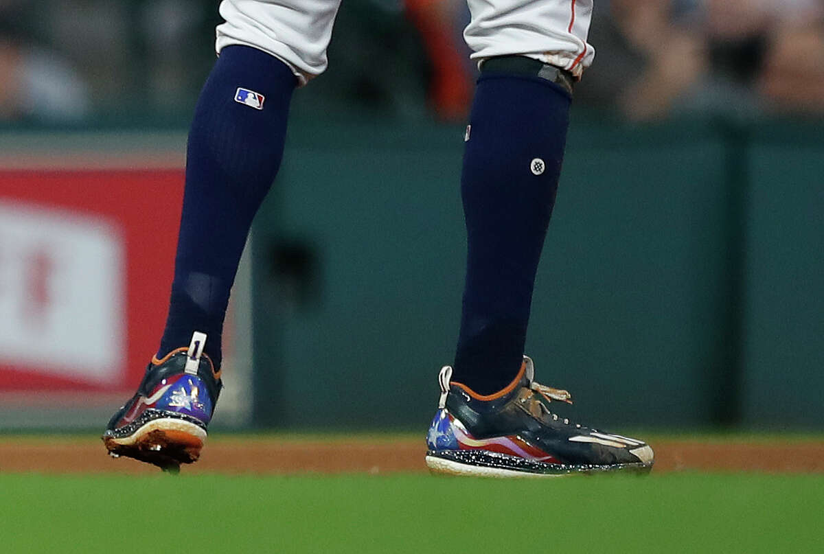 Carlos Correa shows his love for his native Puerto Rico by wearing shoes adorned with the country's flag during Tuesday night's game.