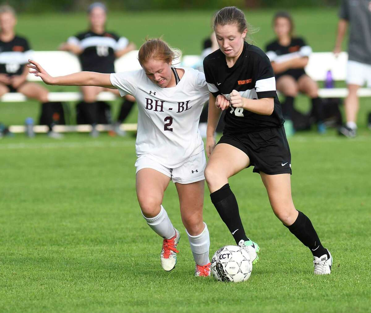 Burnt Hills-Ballston Lake's Grace Holzman (2) and Bethlehem's Grace Hotaling (14) chase the ball between during the first half of a girl's high school soccer game on Tuesday, Sept. 19, 2017, in Burnt Hills, N.Y. (Hans Pennink / Special to the Times Union) ORG XMIT: HP106