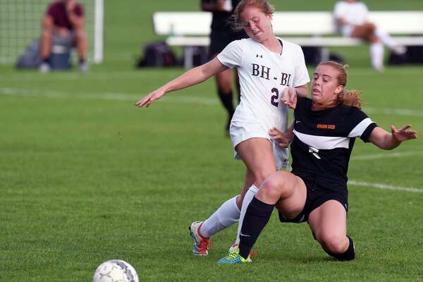 Burnt Hills-Ballston Lake's Grace Holzman (2) and Bethlehem's Shannon Donnelly (15) chase the ball between during the first half of a girl's high school soccer game on Tuesday, Sept. 19, 2017, in Burnt Hills, N.Y. (Hans Pennink / Special to the Times Union) ORG XMIT: HP112