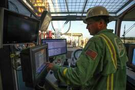 Precision Drilling's Steve Brouwer  works in the control room of a new drilling rig assembled at its plant in Houston.