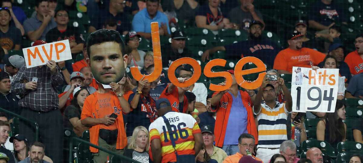 Houston Astros fans hold up signs for Jose Altuve during the sixth inning of an MLB baseball game at Minute Maid Park, Tuesday, Sept. 19, 2017, in Houston.