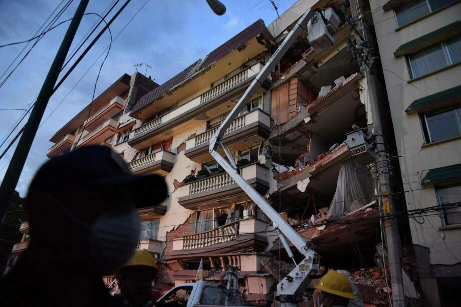 Rescuers, firefighters, policemen, soldiers and volunteers remove rubble and debris from a flattened building in search of survivors after a powerful quake in Mexico City on September 19, 2017. A devastating quake in Mexico on Tuesday killed more than 100 people, according to official tallies, with a preliminary 30 deaths recorded in the capital where rescue efforts were still going on. / AFP PHOTO / YURI CORTEZYURI CORTEZ/AFP/Getty Images Photo: YURI CORTEZ / AFP/Getty Images / AFP or licensors