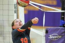 FILE PHOTO: Danbury Megan Mercer get under the ball, keeping in play against Westhill during an FCIAC conference volleyball match at West Hill high School in Stamford, Conn. on Wednesday, Sept.21, 2016.