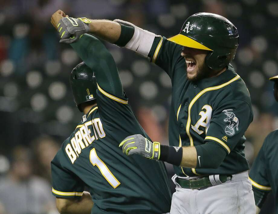 DETROIT, MI - SEPTEMBER 19:  Jed Lowrie #8 of the Oakland Athletics celebrates with Franklin Barreto #1 of the Oakland Athletics after hitting a grand slam to take a 9-8 lead over the Detroit Tigers during the eighth inning at Comerica Park on September 19, 2017 in Detroit, Michigan. (Photo by Duane Burleson/Getty Images) Photo: Duane Burleson, Getty Images