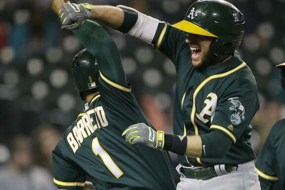 DETROIT, MI - SEPTEMBER 19:  Jed Lowrie #8 of the Oakland Athletics celebrates with Franklin Barreto #1 of the Oakland Athletics after hitting a grand slam to take a 9-8 lead over the Detroit Tigers during the eighth inning at Comerica Park on September 19, 2017 in Detroit, Michigan. (Photo by Duane Burleson/Getty Images)