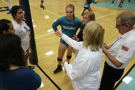 As Ashleigh Crum and head coach Kasie Fernandez look on, referee Dede McPherson conducts the coin flip to see who serves first prior to Tuesday night's 22-6A match.