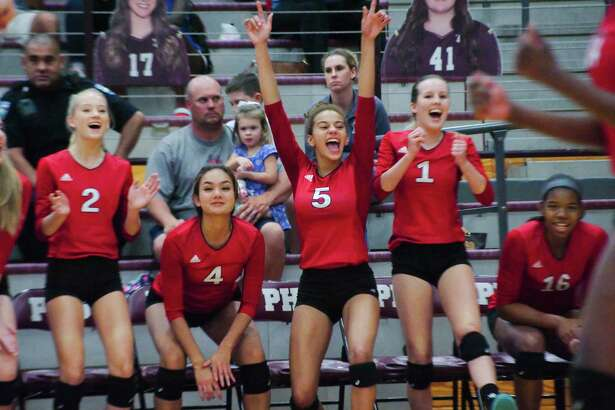 Dawson players celebrate a point against Pearland Tuesday, Sep. 19 at Pearland High School.