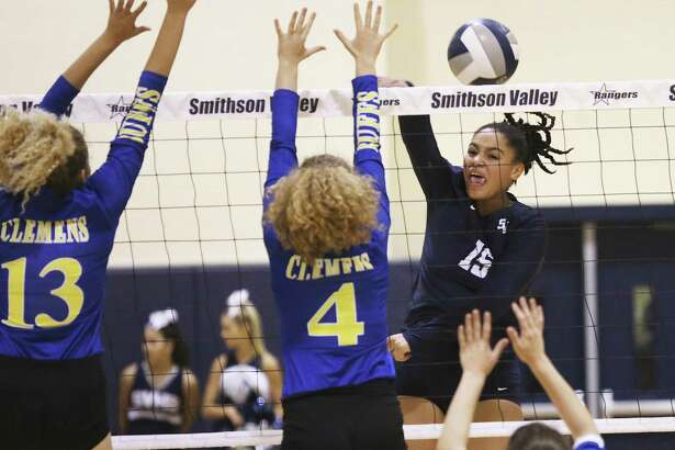 The Rangers' Tanyse Moehrig slips a shot by Kaiden Kirby (13) and Mackenzie Miller as Smithson Valley hosts Clemens in volleyball on September 19, 2017.